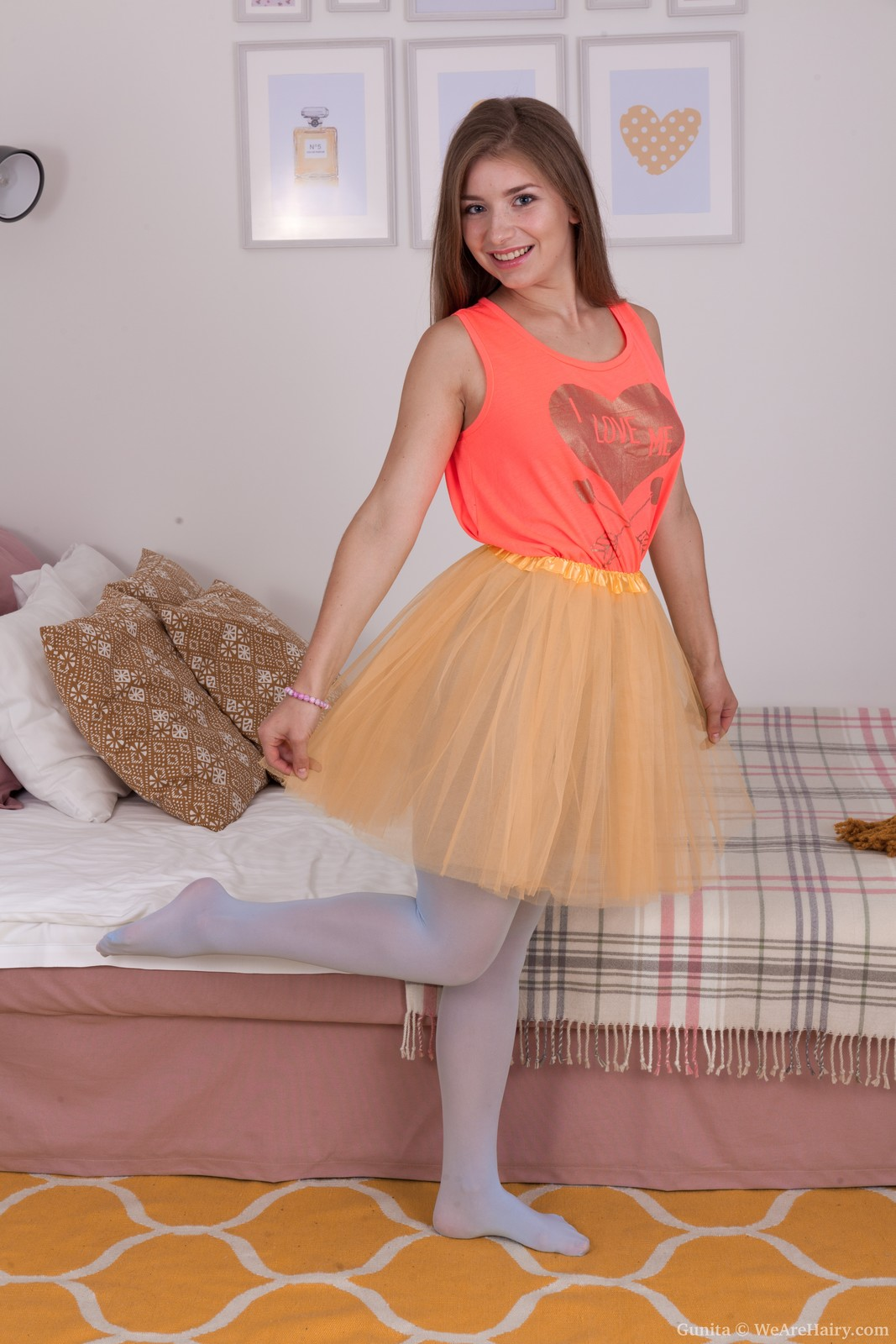 Gorgeous teen with puffy nipples Gunita spreads her furry pussy