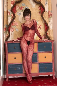 Gorgeous hairy lady Kate Anne plays in her body stocking and high heels