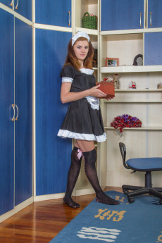Natural pussy french maid Milana S strips naked to please