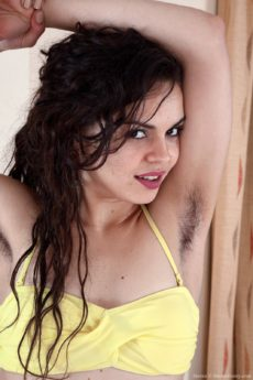 Beautiful exotic Sierra takes off her yellow bikini and shows us her hairy pits and crack