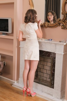 Sultry brunette with luxurious locks Vita disrobes and shows her unkempt box