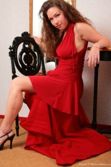 Alissia Is the beautiful hairy lady in red