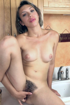 Exotic cutie Amber Faye shoves a few fingers into her hairy hole