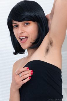 Fit hairy girl Andy Moon wearing a wig bends over spreading her droopy lips
