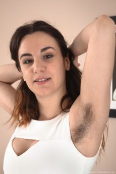 Hairy brunette Aragne takes off her sexy white dress and spreads her big lips