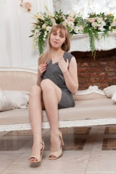 Slim blonde Beatrice disrobes and shows her pretty furry pussy and her feet