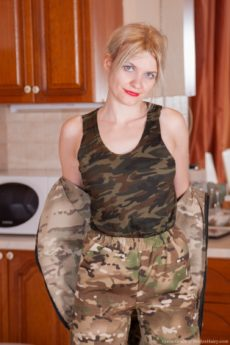 Blonde looker Greta Grace wearing camouflage and giving you a peek