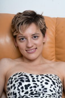 Short haired amateur Calina bends over and shows her furry beaver
