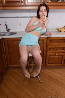 Chrystal Mirror eats a banana and bares her furry minge