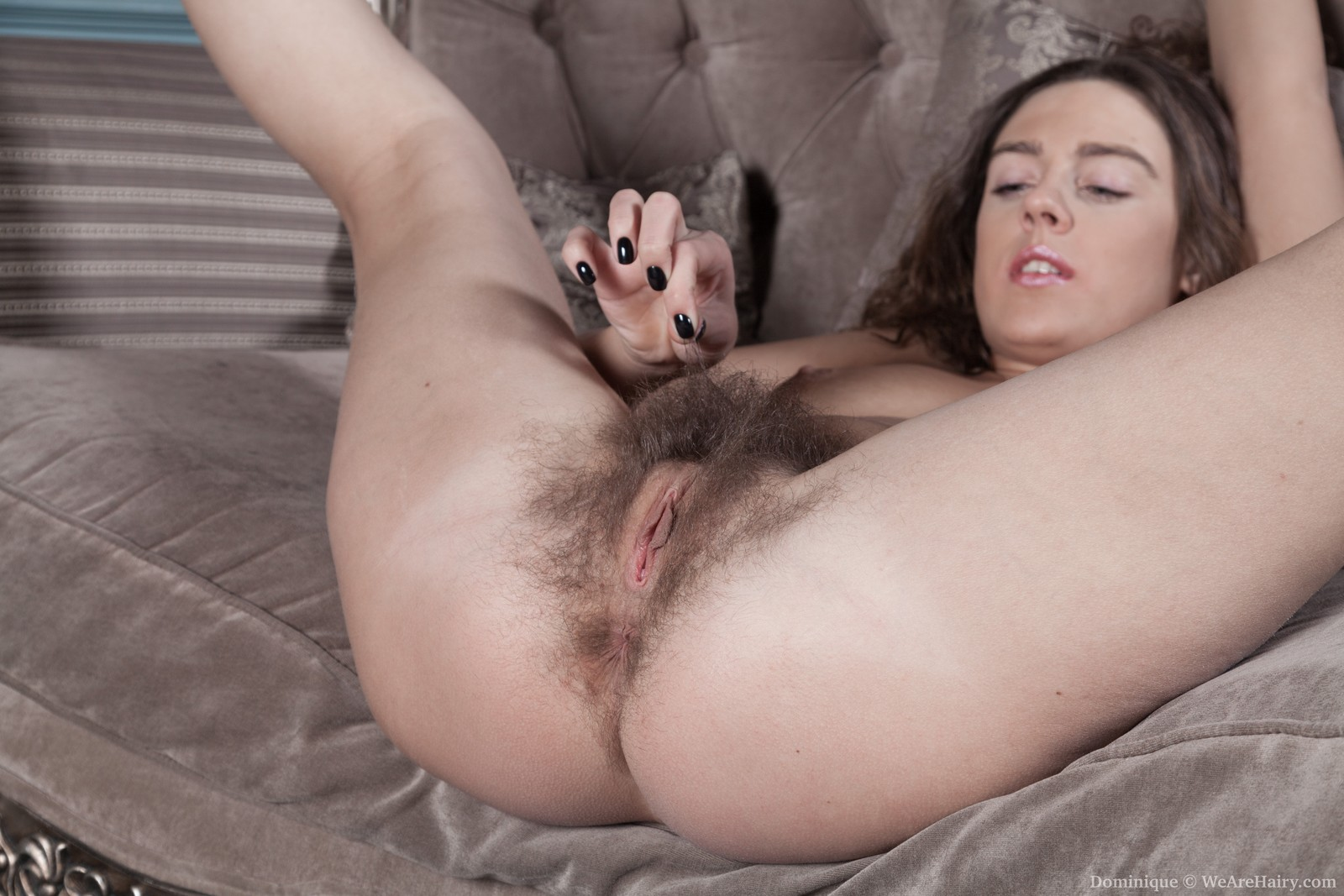 dominique-touches-her-hairy-body-on-a-couch12.jpg