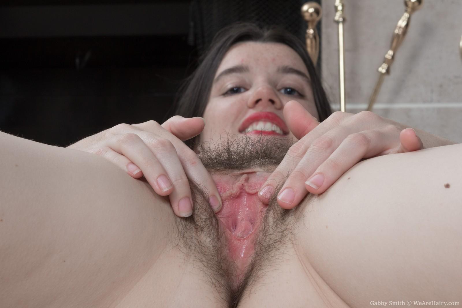 gabby-smith-strips-nude-by-her-fireplace10.jpg