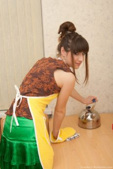 Hairy 18 year old Natasha gets naked in the kitchen
