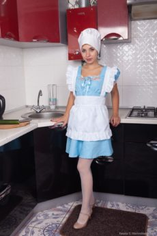 Hairy maid Tanita gives a hairy pussy show in the kitchen