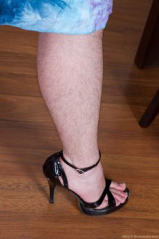 hairy Mary strips on her table and uses her dildo