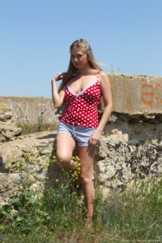 Hirsute blonde Riana S takes off her red top and shorts outside