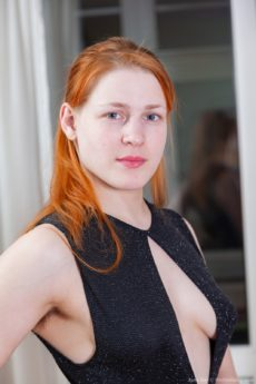Striking ginger Jana Bay gets fully naked