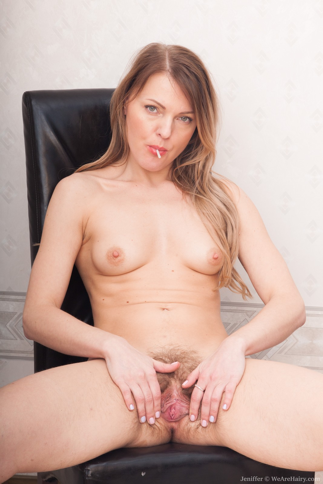 jeniffer-is-loving-her-lollipop-today-in-her-sexy-black-outfit.-she-strips-naked-enjoying-it-and-brushes-it-along-her-hairy-pussy.-she-then-slides-fingers-inside-her-pussy-to-masturbate-and-get-off.7.jpg