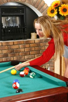 Julia plays pool with her thick bush out