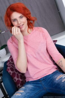 Striking red haired Kristina Amanda spreads her naturally furry labia up close