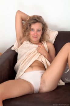 Hairy blonde girl Manon is horny and naked on the sofa