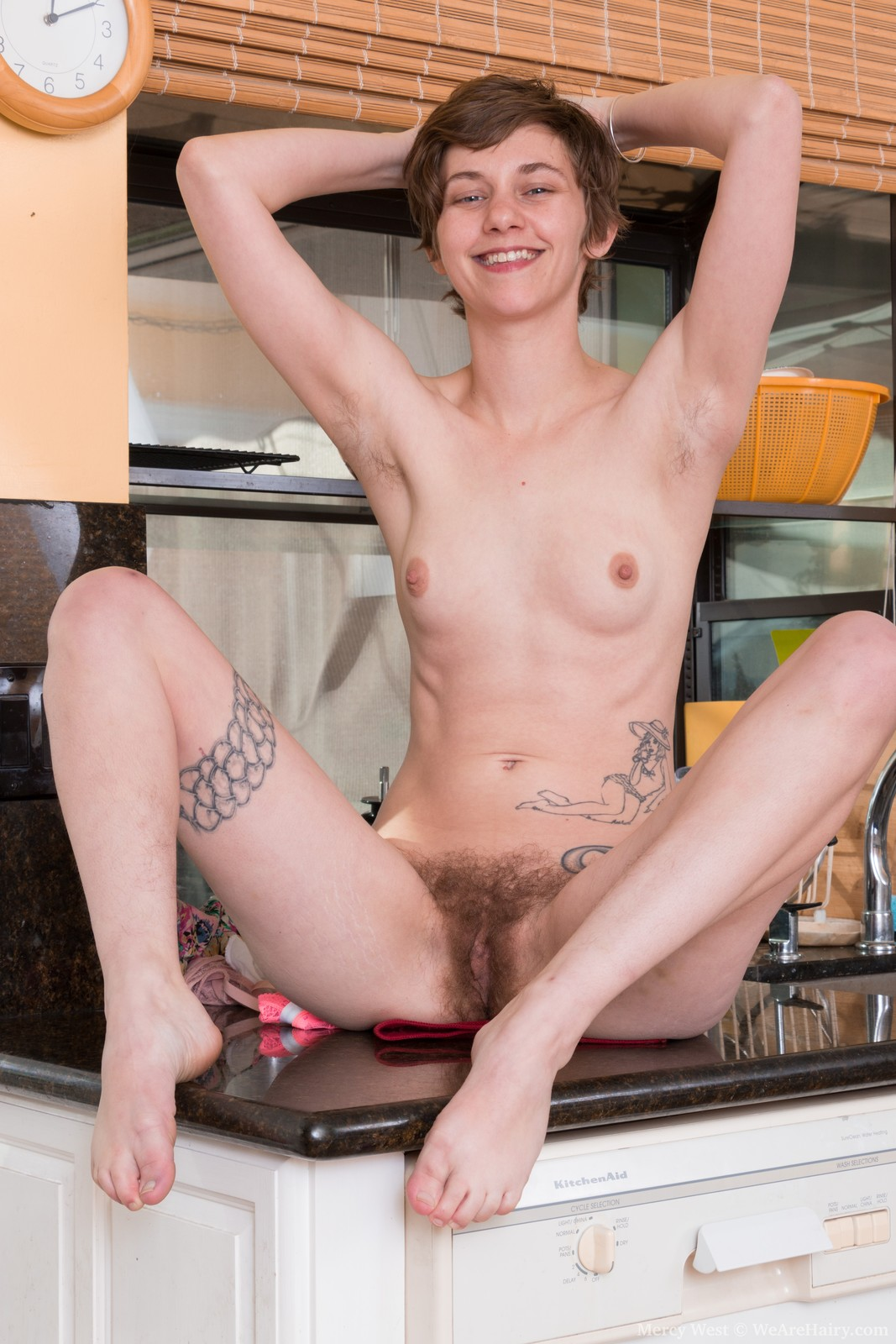 mercy-west-is-enjoying-herself-in-her-kitchen-and-showing-off-her-body-with-stockings.-she-strips-naked-and-has-hairy-pits-and-a-hairy-pussy-to-enjoy.-she-teases-us-with-sexy-looks-and-pleasure.12.jpg