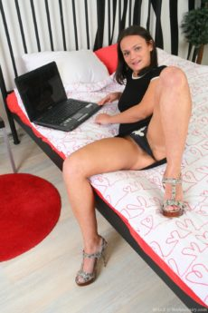 Mila Z watches porn on her laptop