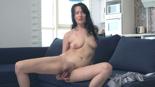 Naughty MILF Nimfa Mannay masturbates and plays with her saggy breasts