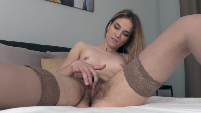 In her sexy stockings, Rosi has fun alone and nude in bed