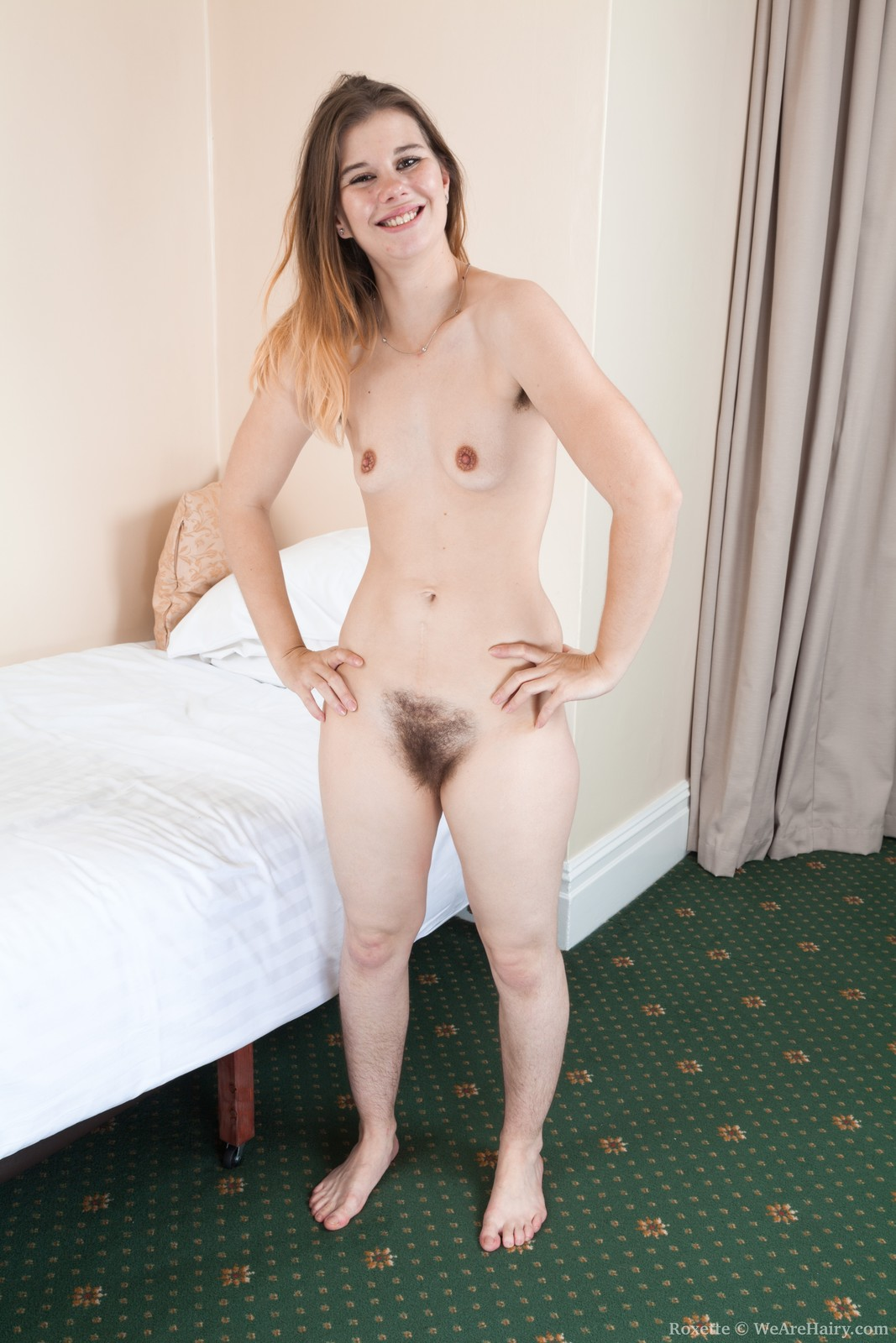 roxette-is-playing-around-in-her-bedroom-and-stroking-her-hairy-pits.-she-strips-nude-and-we-really-can-enjoy-her-hairy-pussy-and-34b-breasts.-she-lays-back-and-is-quite-a-beautiful-hairy-body.12.jpg