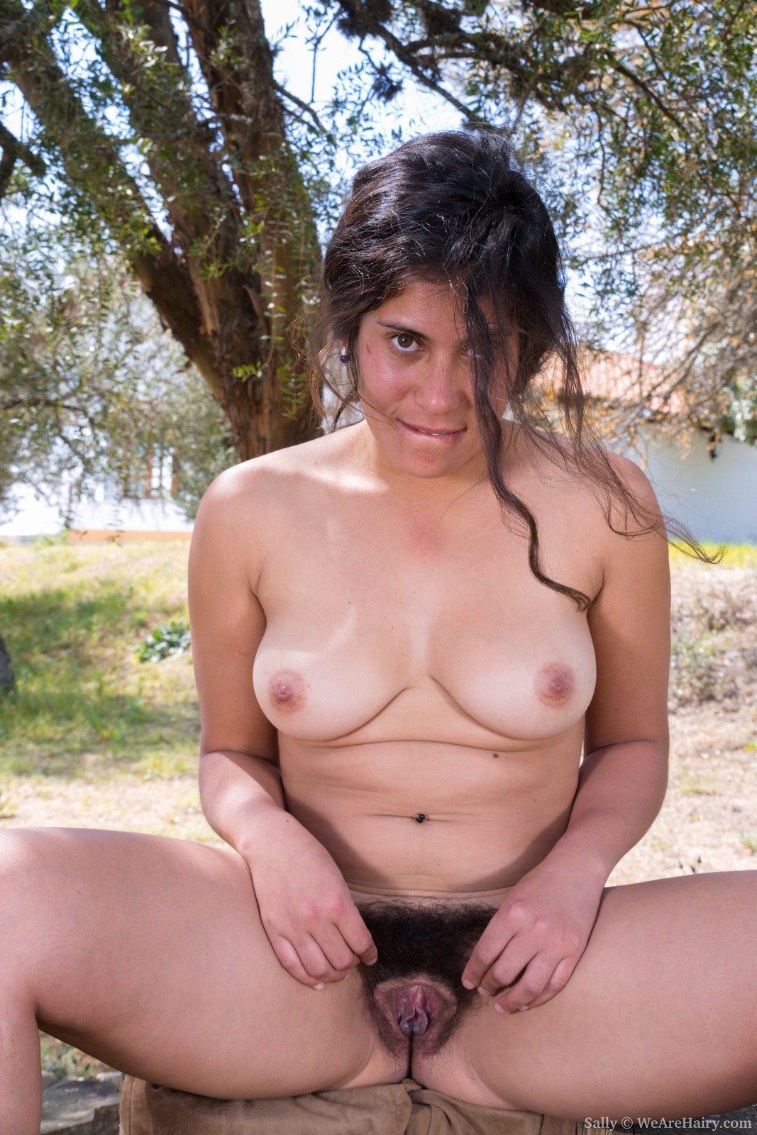 sally-is-outdoors-enjoying-the-sun-and-wants-to-get-some-sun-on-her-naked-body.-she-strips-naked-and-shows-off-her-36c-breasts-and-hairy-pussy.-her-body-is-sexy-outside-and-her-bush-is-so-beautiful.10.jpg