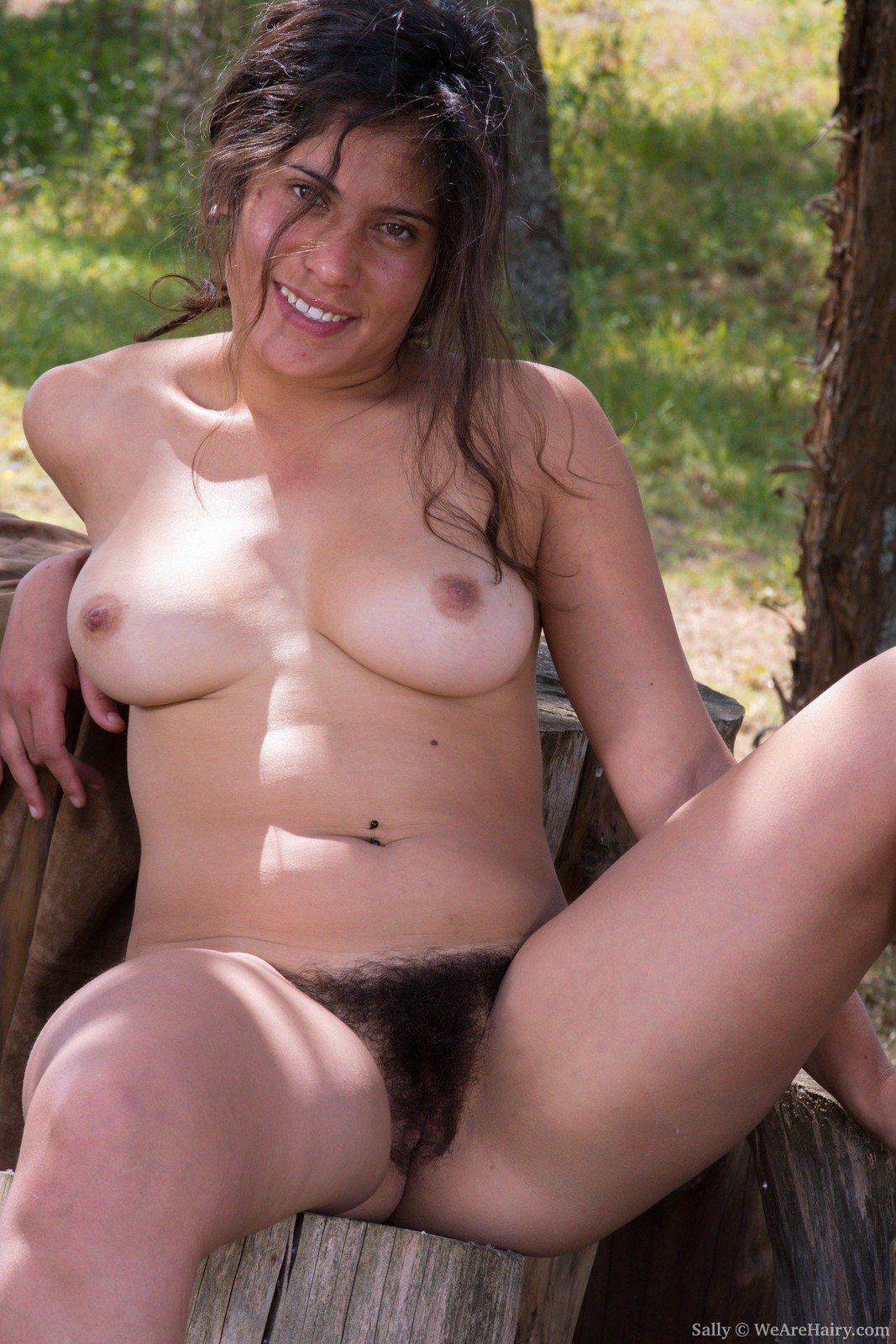sally-is-outdoors-enjoying-the-sun-and-wants-to-get-some-sun-on-her-naked-body.-she-strips-naked-and-shows-off-her-36c-breasts-and-hairy-pussy.-her-body-is-sexy-outside-and-her-bush-is-so-beautiful.16.jpg