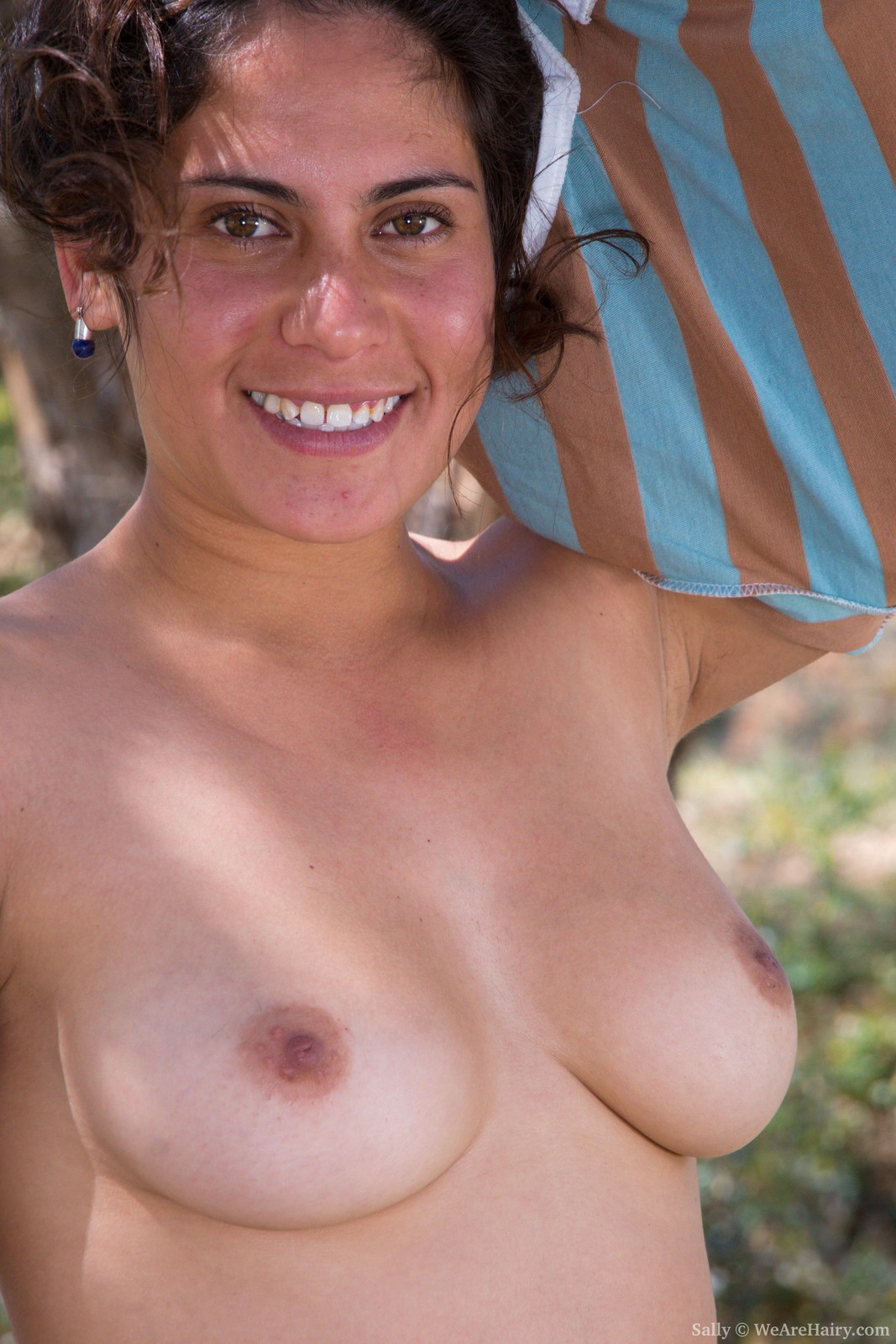 sally-is-outdoors-enjoying-the-sun-and-wants-to-get-some-sun-on-her-naked-body.-she-strips-naked-and-shows-off-her-36c-breasts-and-hairy-pussy.-her-body-is-sexy-outside-and-her-bush-is-so-beautiful.2.jpg