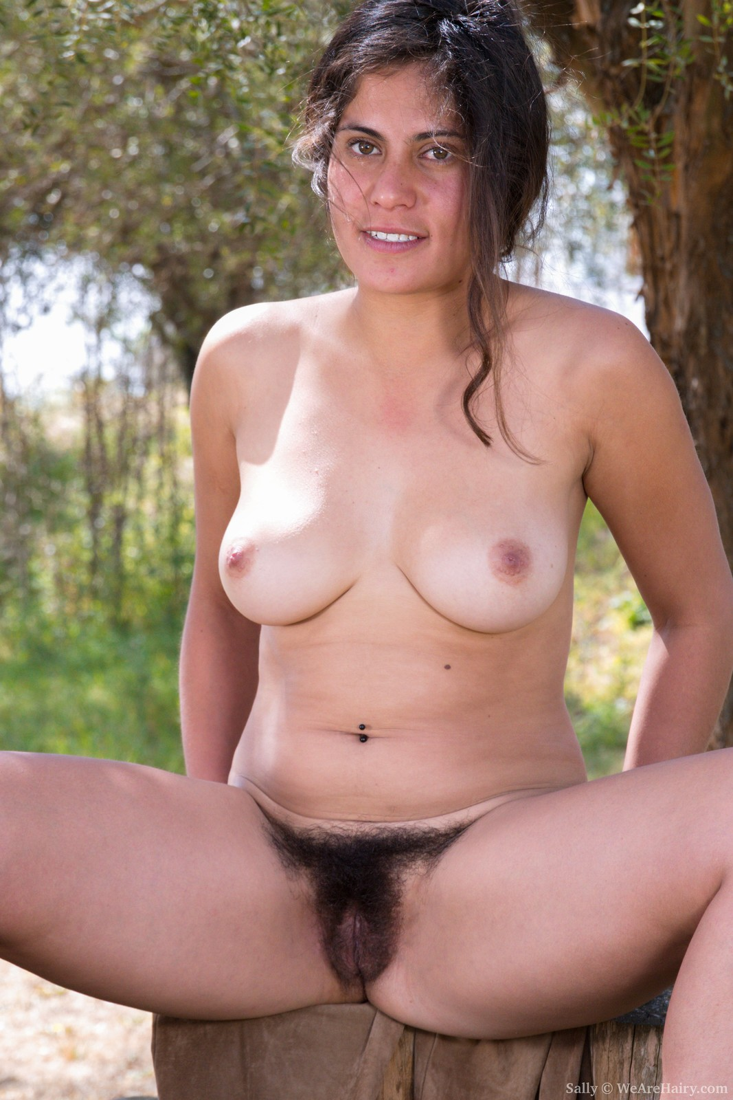 sally-is-outdoors-enjoying-the-sun-and-wants-to-get-some-sun-on-her-naked-body.-she-strips-naked-and-shows-off-her-36c-breasts-and-hairy-pussy.-her-body-is-sexy-outside-and-her-bush-is-so-beautiful.7.jpg