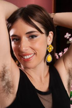 Hot hirsute brunette Simone takes off her sexy black dress