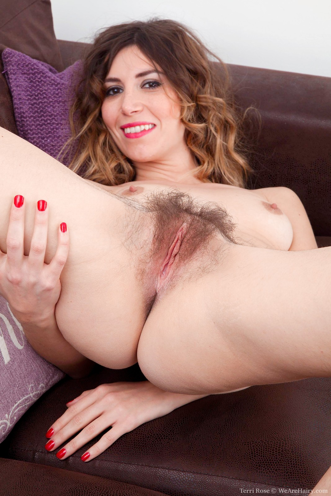 terri-rose-is-in-her-white-dress-on-her-purple-sofa-and-showing-off-her-very-hairy-pits.-she-strips-naked-and-shows-us-her-hairy-pussy-too.-she-bends-over-spreads-wide-and-shows-all-of-it-off-for-us.12.jpg
