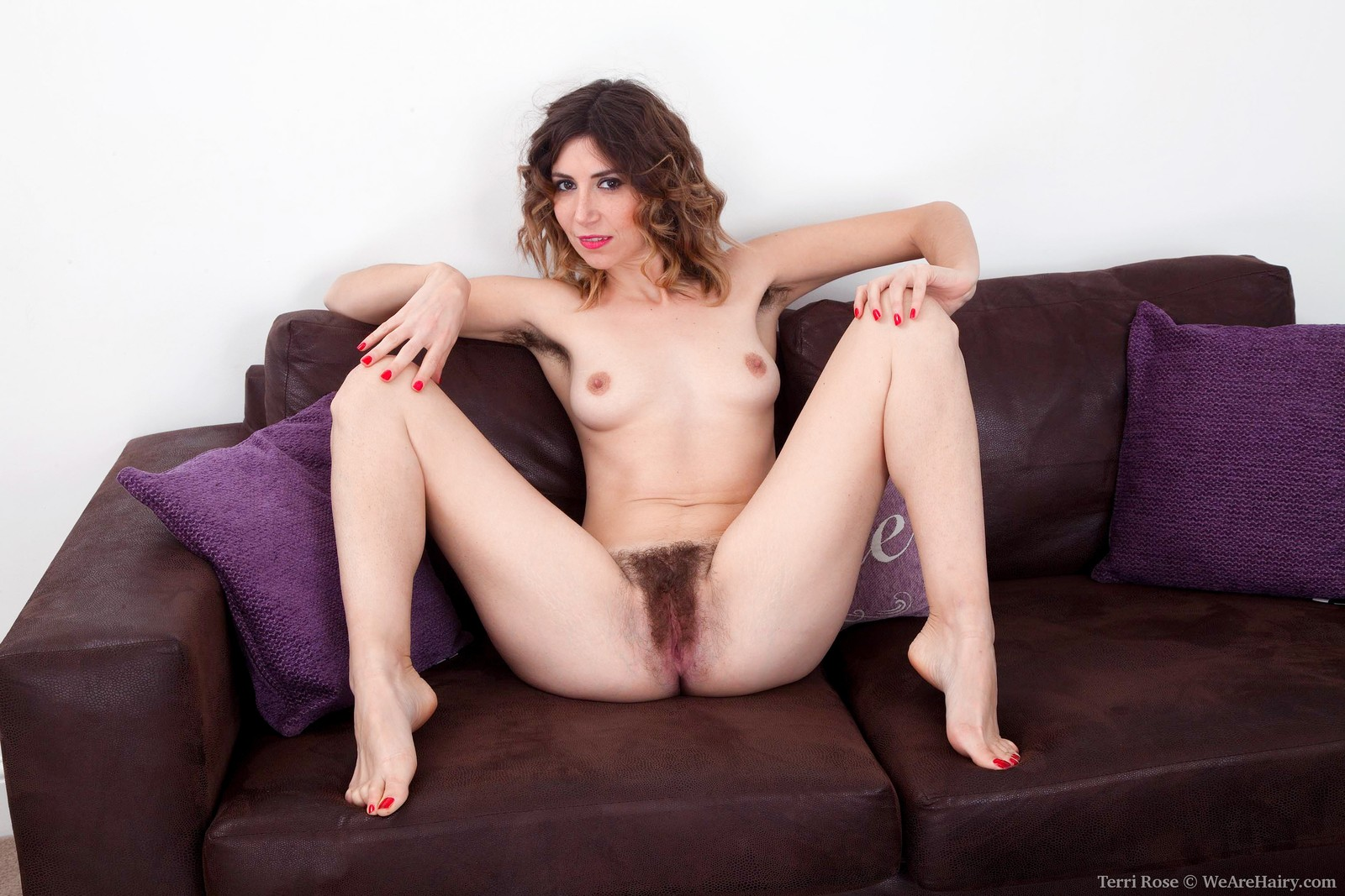 terri-rose-is-in-her-white-dress-on-her-purple-sofa-and-showing-off-her-very-hairy-pits.-she-strips-naked-and-shows-us-her-hairy-pussy-too.-she-bends-over-spreads-wide-and-shows-all-of-it-off-for-us.9.jpg