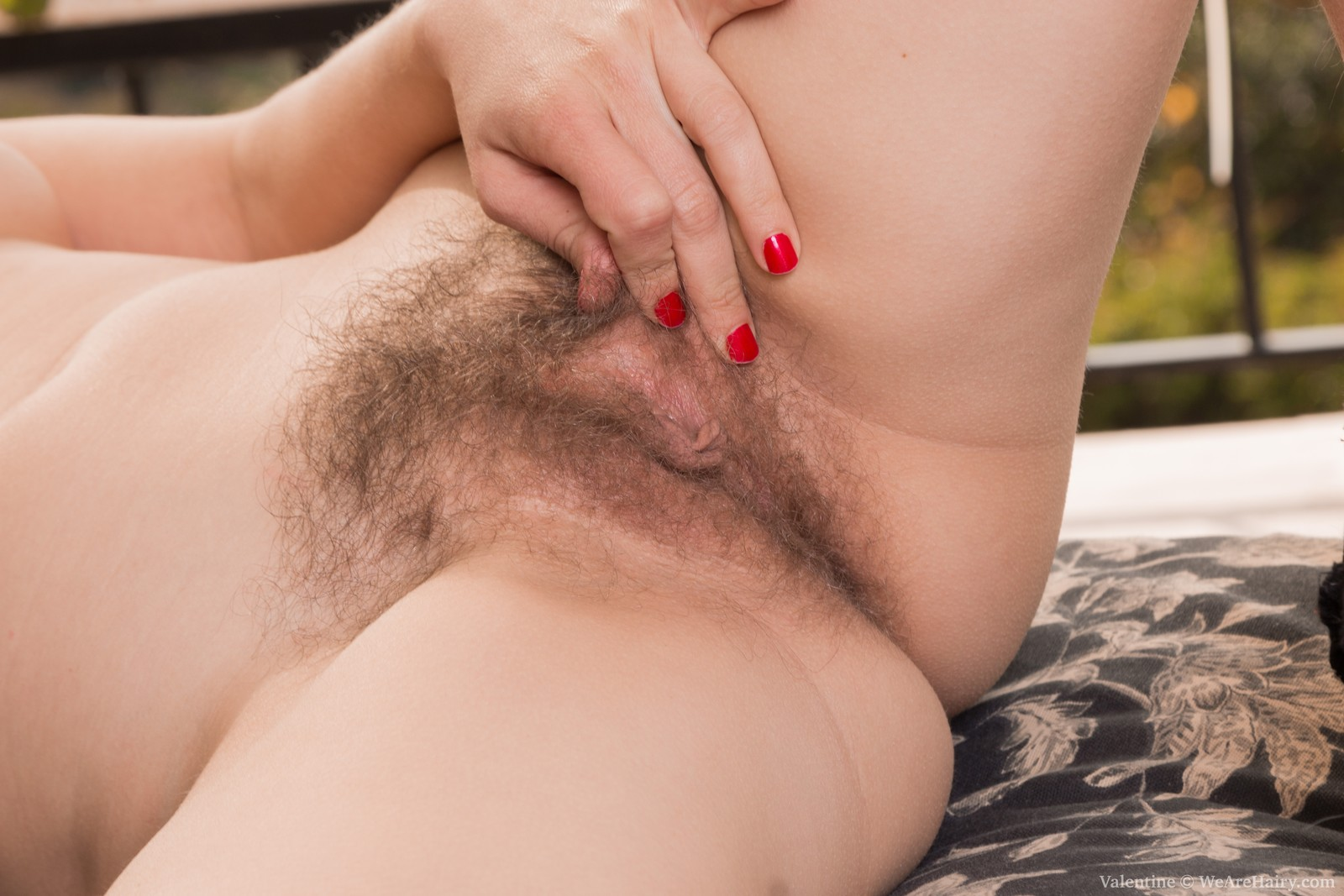 valentine-is-laying-on-her-lounge-chair-on-her-balcony-and-stroking-her-hairy-pits-and-hairy-bush.-she-takes-it-all-off-and-strokes-her-pink-pussy-lips-and-bush.-she-smiles-and-enjoys-being-naked-for-us.11.jpg