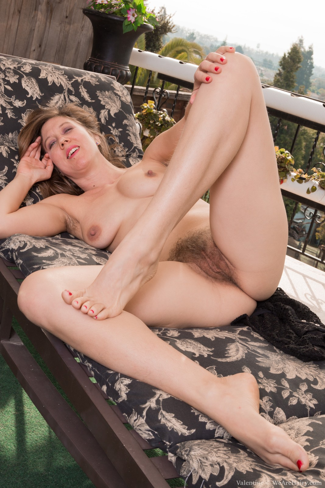 valentine-is-laying-on-her-lounge-chair-on-her-balcony-and-stroking-her-hairy-pits-and-hairy-bush.-she-takes-it-all-off-and-strokes-her-pink-pussy-lips-and-bush.-she-smiles-and-enjoys-being-naked-for-us.13.jpg