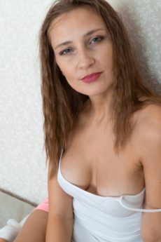 Cute and casual Victoria takes off her camisole and shorts then spreads her muff