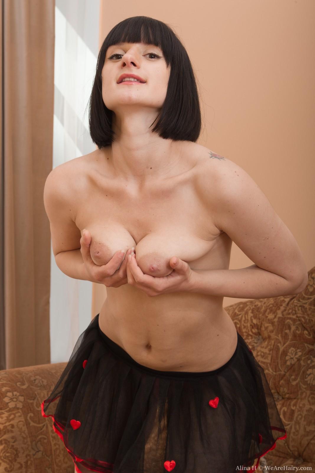wpid-alina-h-puts-on-sexy-strip-show-on-her-sofa5.jpg