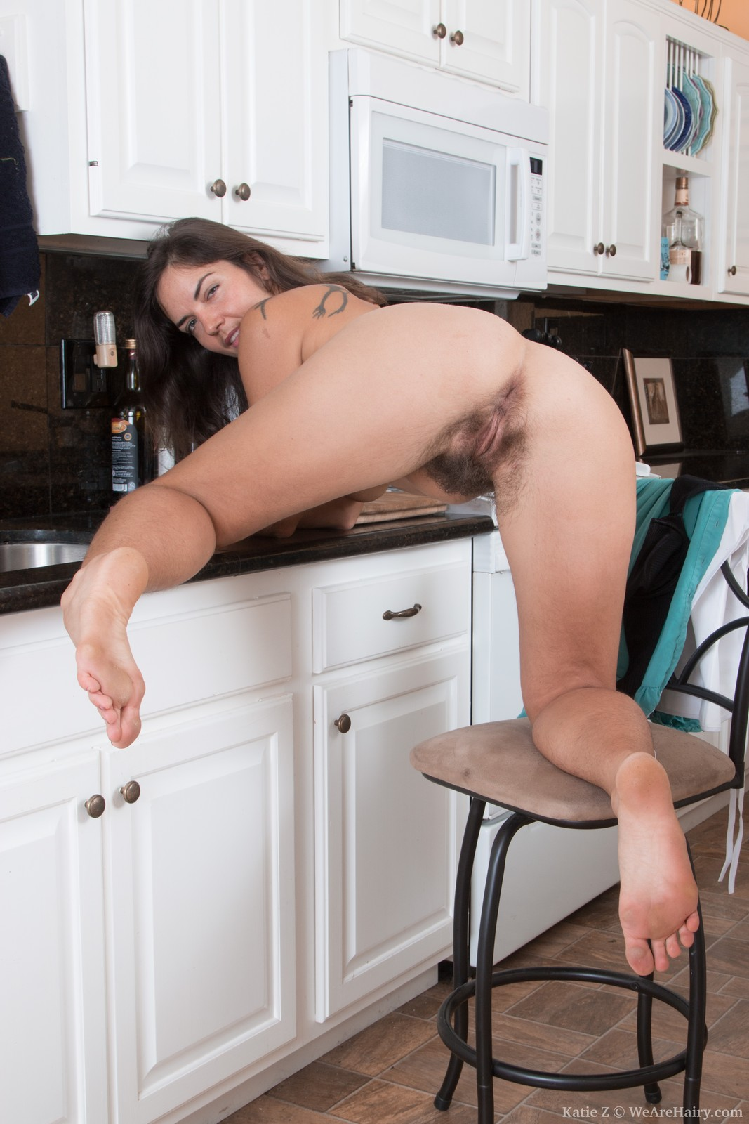 wpid-katie-z-strips-off-blue-dress-in-her-kitchen11.jpg
