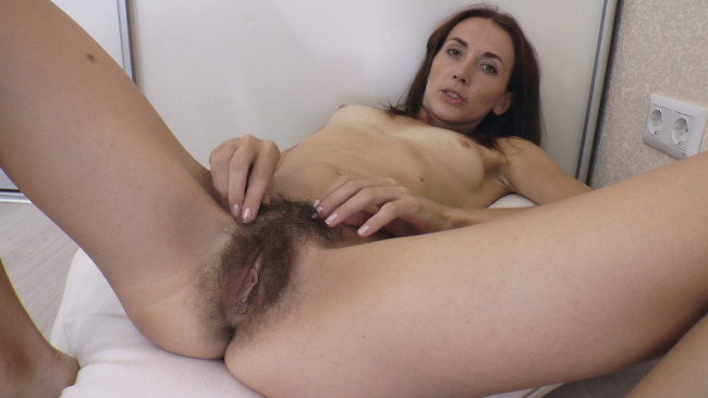 Skinny tall brunette Scarlett Nika gets naked and spreads her fur pie