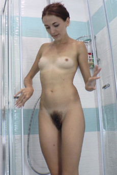 Tiny tits babe Scarlett Nika gets in the shower and cleans off her sweaty hairy bush